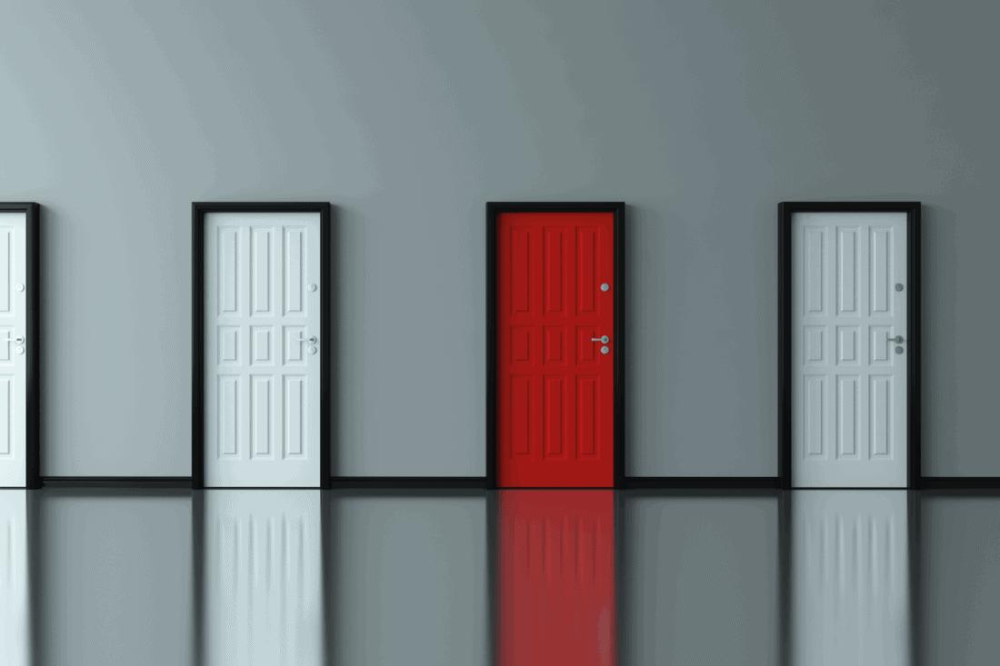 Different red door between the white doors