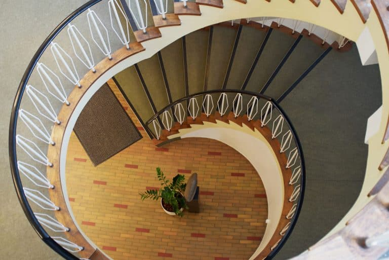 Downside view of a spiral staircase classical desgin architecture element, Where Does A Rug Runner Go? [7 Excellent Ideas To Try!]