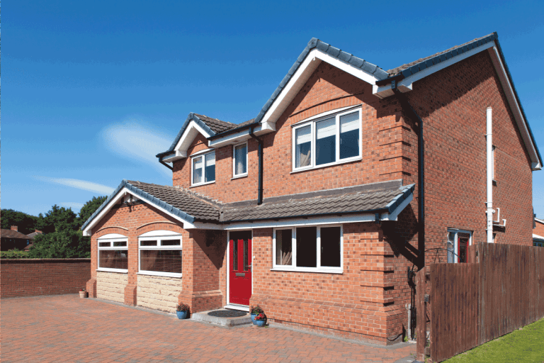 English detached red brick house with red door. What Color Pavers Go With Red Brick House