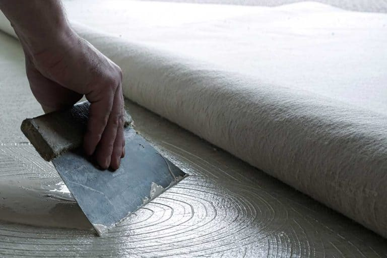 Floor fitter when applying adhesive on the floor, Can You Paint Over Carpet Glue?