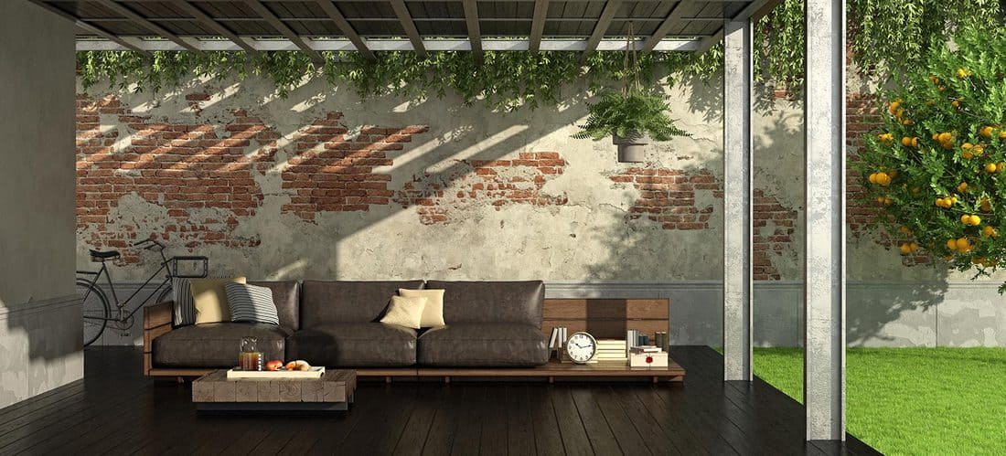 Garden with iron pergola and rustic style sofa