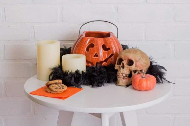 Halloween decoration on top of a round side table, 13 Spooky And Spectacular Halloween Decorations For Your Front Porch