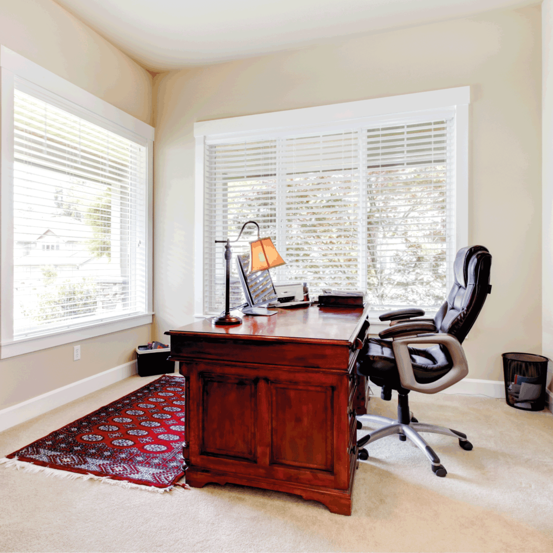 Home office with mahogany desk and leather chair