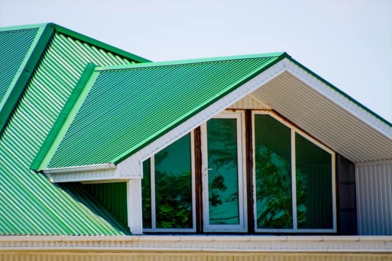 House with plastic windows and a green roof of corrugated sheet, What Color House Goes With A Green Roof?