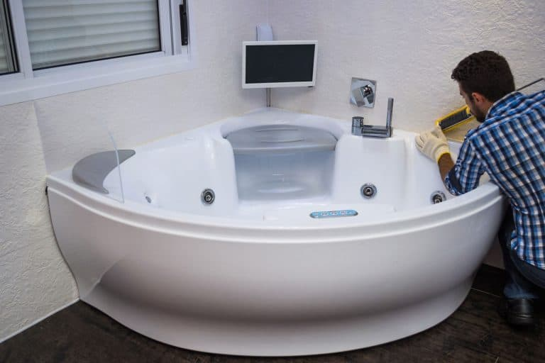 Installation of modern bathtub, (hot tub), applying sealant, bathtub with tv, How To Update An Old Jacuzzi Tub - 3 Methods To Consider
