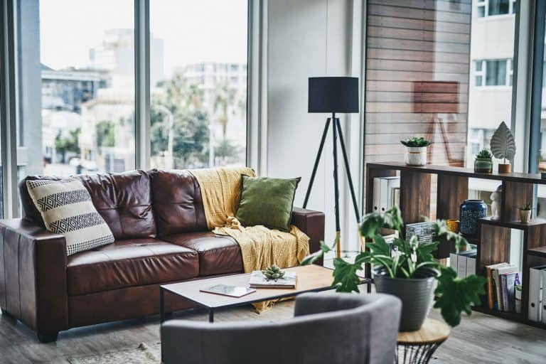 Interior of a modern cozy condominium living room with earthy, Should A Coffee Table Be Centered?