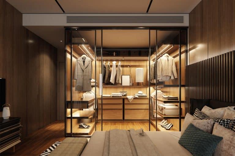 Interior of an empty luxury bedroom with walk-in closet, Do Bedroom Closets Need Doors?