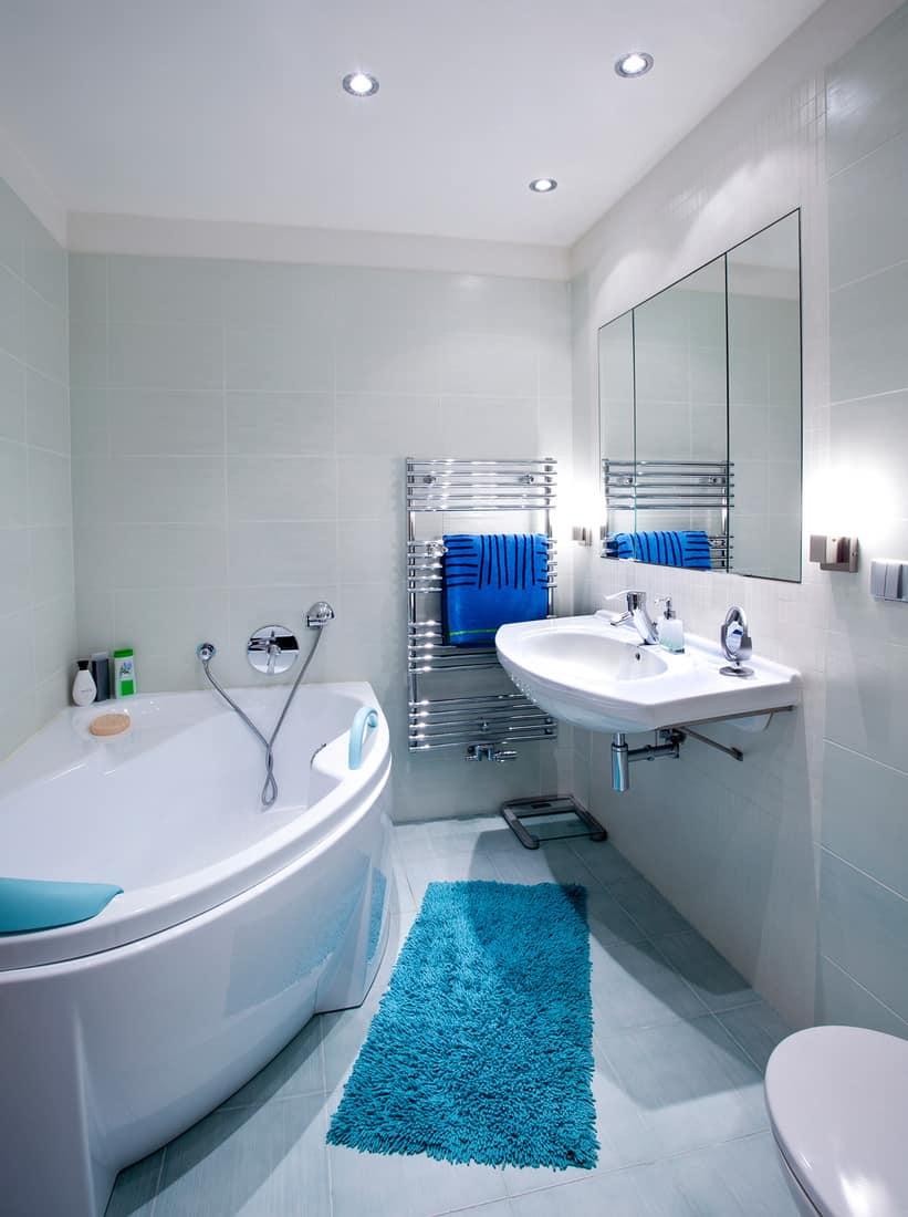 Interior of bathroom with blue bathroom towels