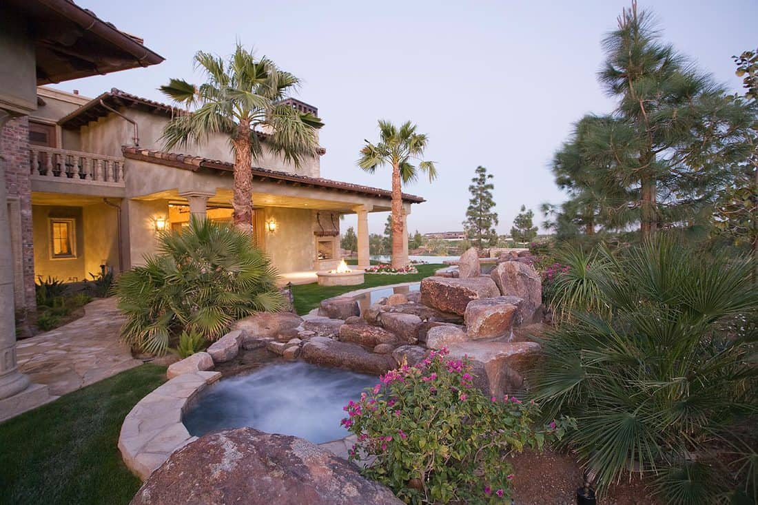 Jacuzzi and house exterior
