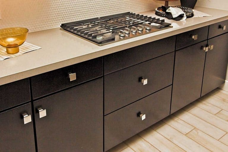 Kitchen counter top with cook top and decorator items, What Color Knobs On Black Cabinets?