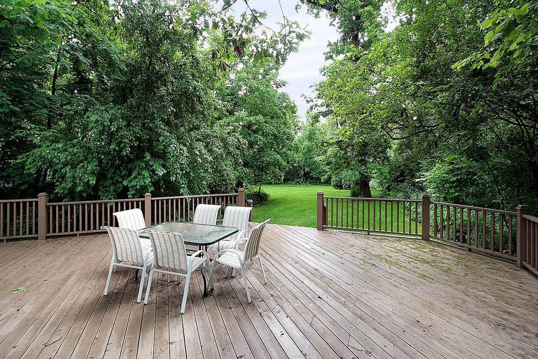 Large deck with chairs and table