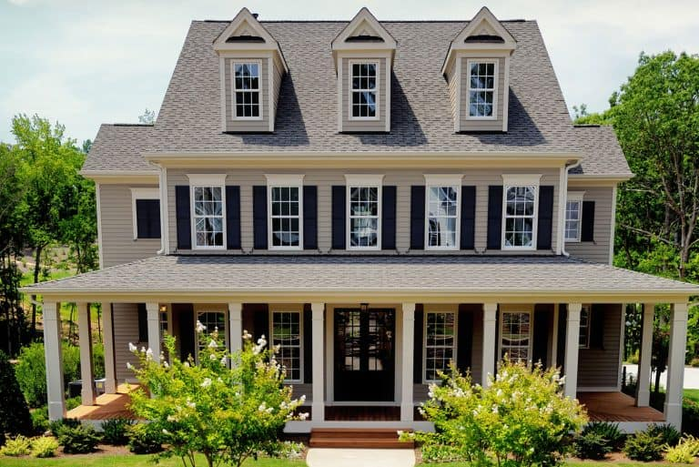 Large suburban home with grey roof, What Color House Goes With A Grey Roof?