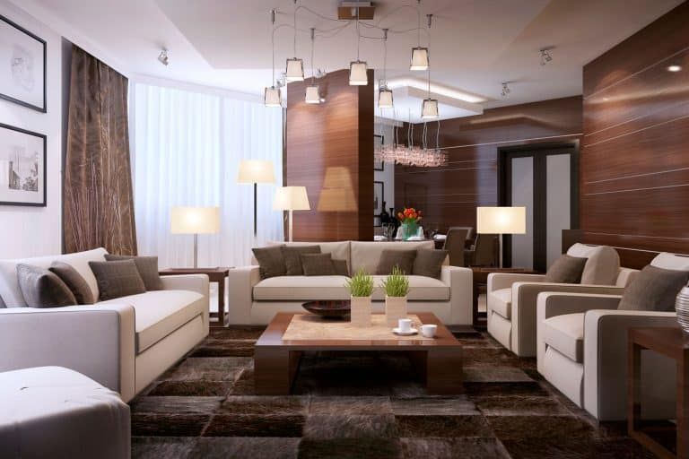 Luxurious and rustic inspired living room with wooden cladding on the walls, dangling lamps, and brown tiles, 11 Awesome Two-Color Combinations For A Living Room