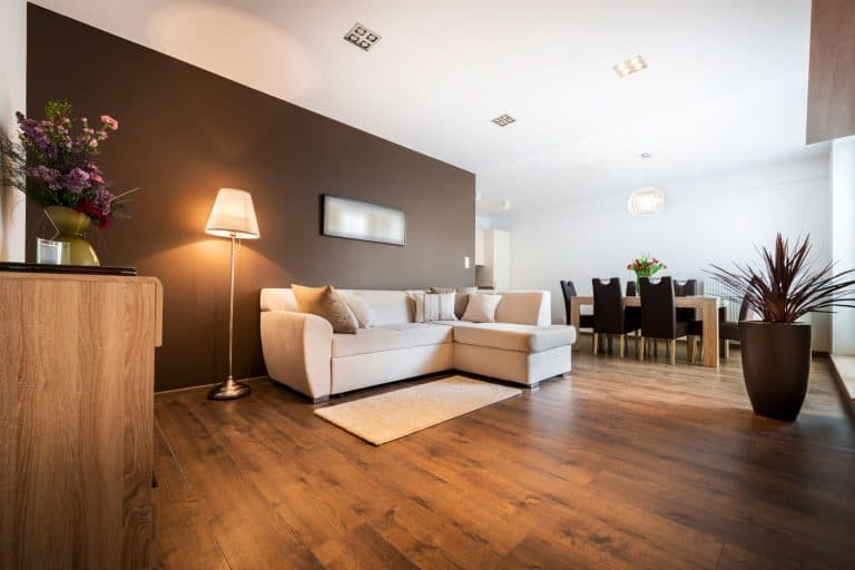 Luxurious living room with kitchen area with hardwood floor, How Long Before You Can Use New Hardwood Floor?