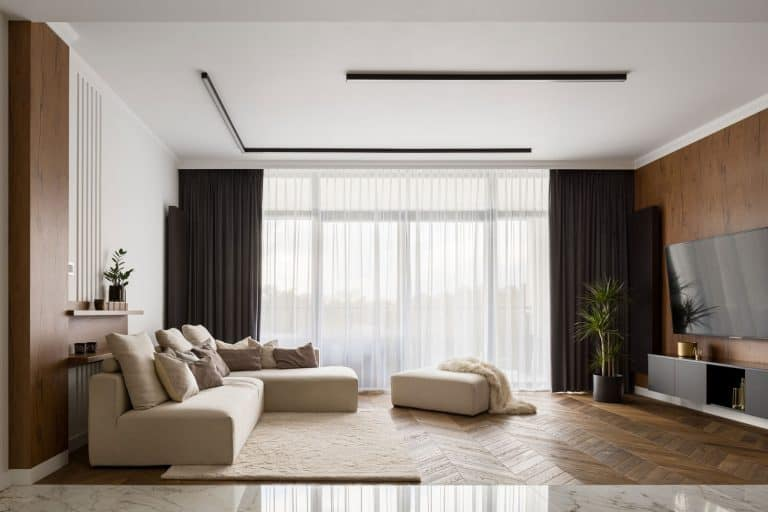 Luxury living room with big beige corner sofa and wooden floor and wall decoration, What Color Walls Go With White Ceiling?