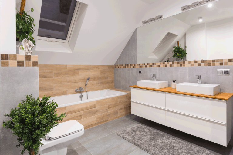 Modern bathroom interior with gray tiles and wooden decors. What Color Vanity With Grey Tile