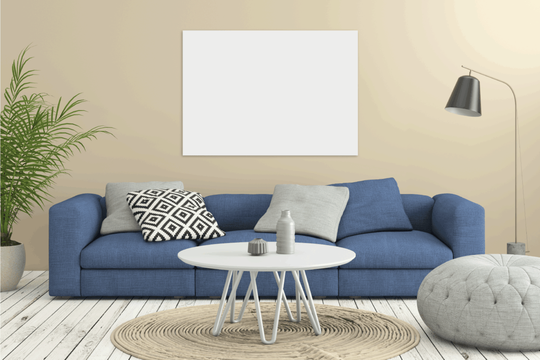 Modern interior, minimalist design style, blue sofa with wall in the background, coffee table, plant