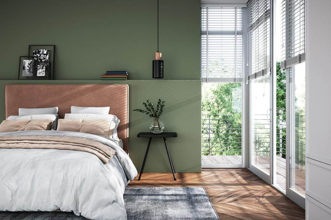 Modern interior of bedroom with green wall