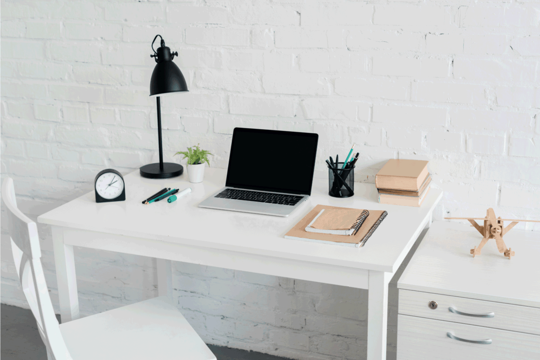 Modern workplace with laptop at home in front of white brick wall. What Color Should I Paint My Desk