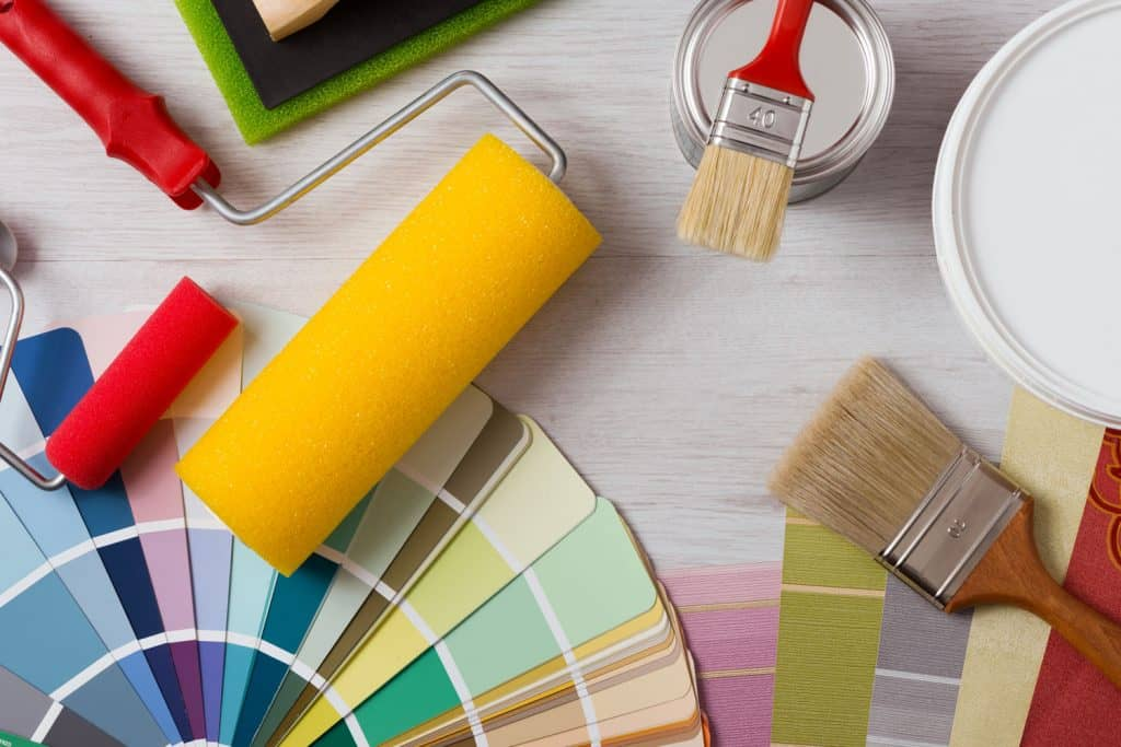 Paint brushes and roller with different color palettes