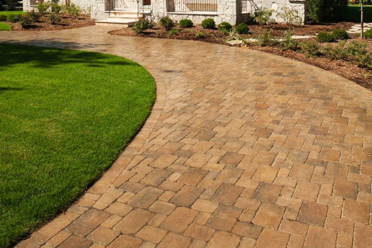Paver driveway leading to a new mansion, What Color Pavers Go With A Brown House?
