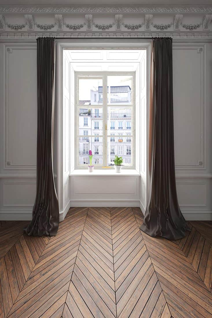 Empty apartment window with curtain
