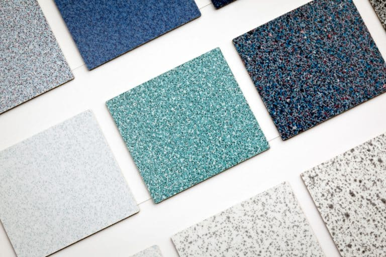 Presentation of several carpet tile flooring samples in various color combinations, 10 Best Glues And Adhesives For Carpet Tiles