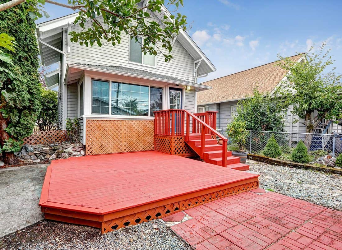 Red empty walkout deck at the backyard