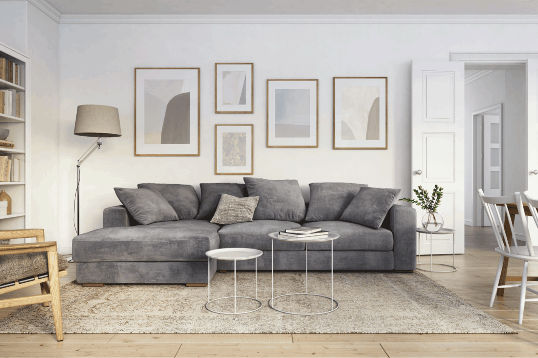 Scandinavian interior design living room with gray and brown colored furniture and wooden elements