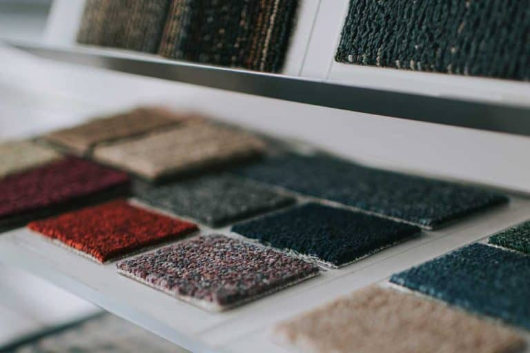 Showroom display with variation of choices on type of carpet tile flooring, How To Install Carpet Tiles - With And Without Glue