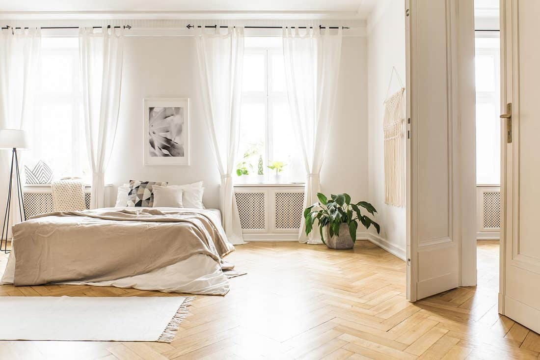 Spacious and bright bedroom interior with beige decorations