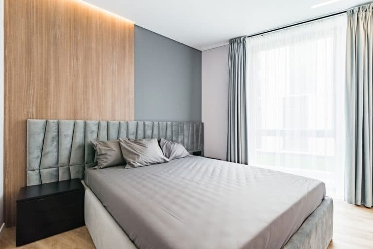 Spacious and modern bedroom, with large, king size bedShould Curtains Match The Wallpaper?
