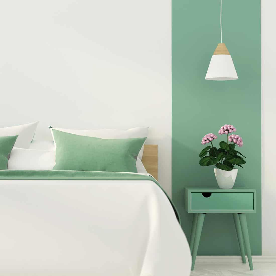 Stylish bedroom with green decoration