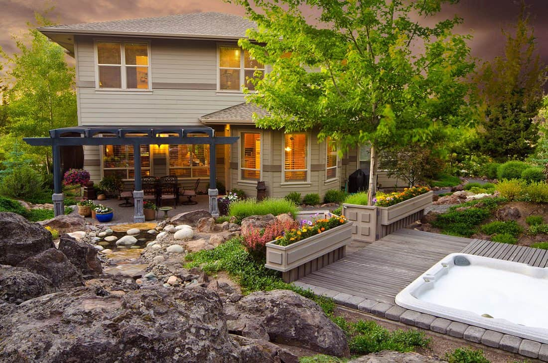 Twilight exterior of home and hot tub