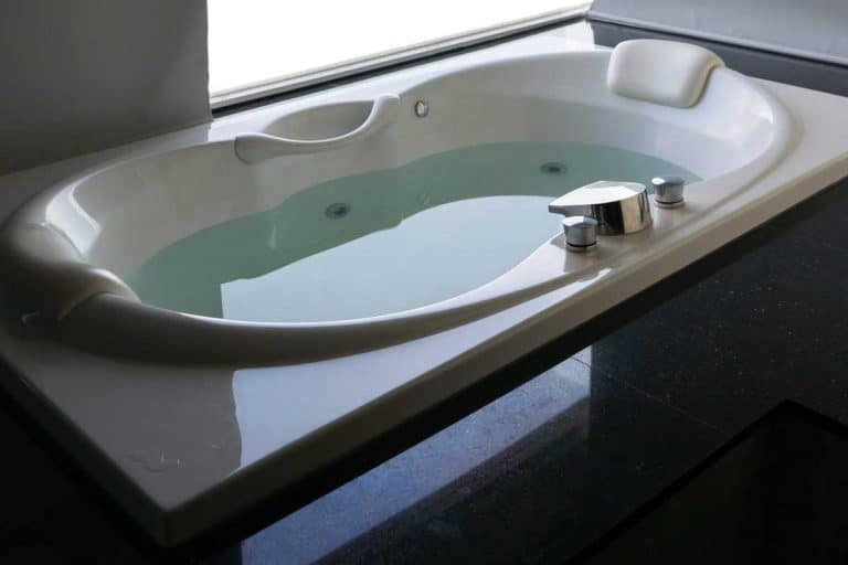 White massaging jetted bathtub, How To Clean A Jetted Tub Filter In 5 Steps