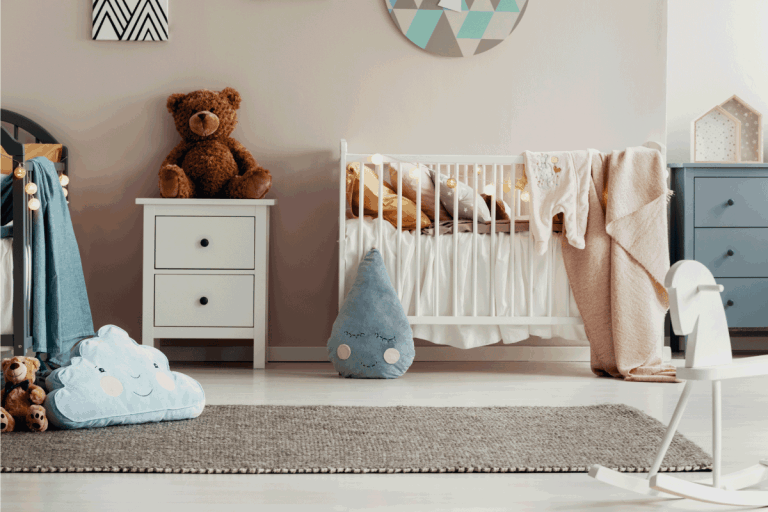White wooden furniture in pastel scandinavian baby bedroom with rug for twins. 11 Bedroom Rug Placement Ideas To Inspire You