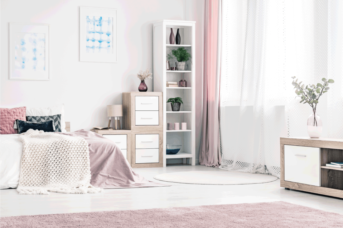 bedroom with feminine and romantic setting, pink and white rug, linen, curtains