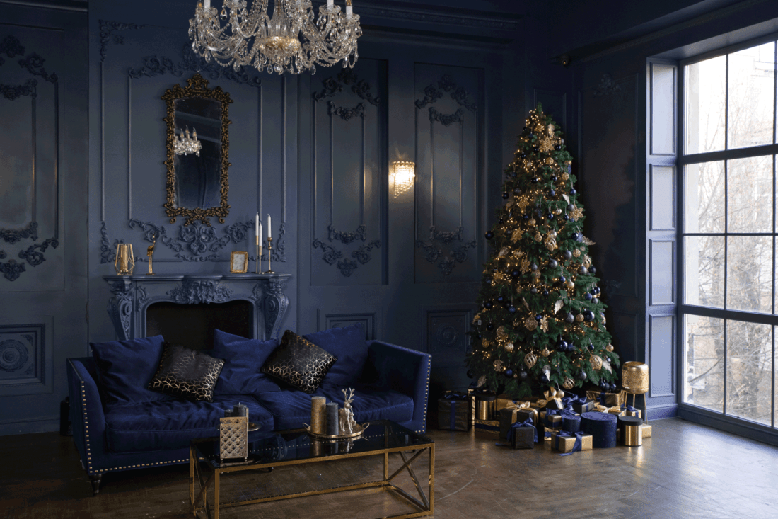 faux living room, classic royalty theme, blue couch and walls, gold decor