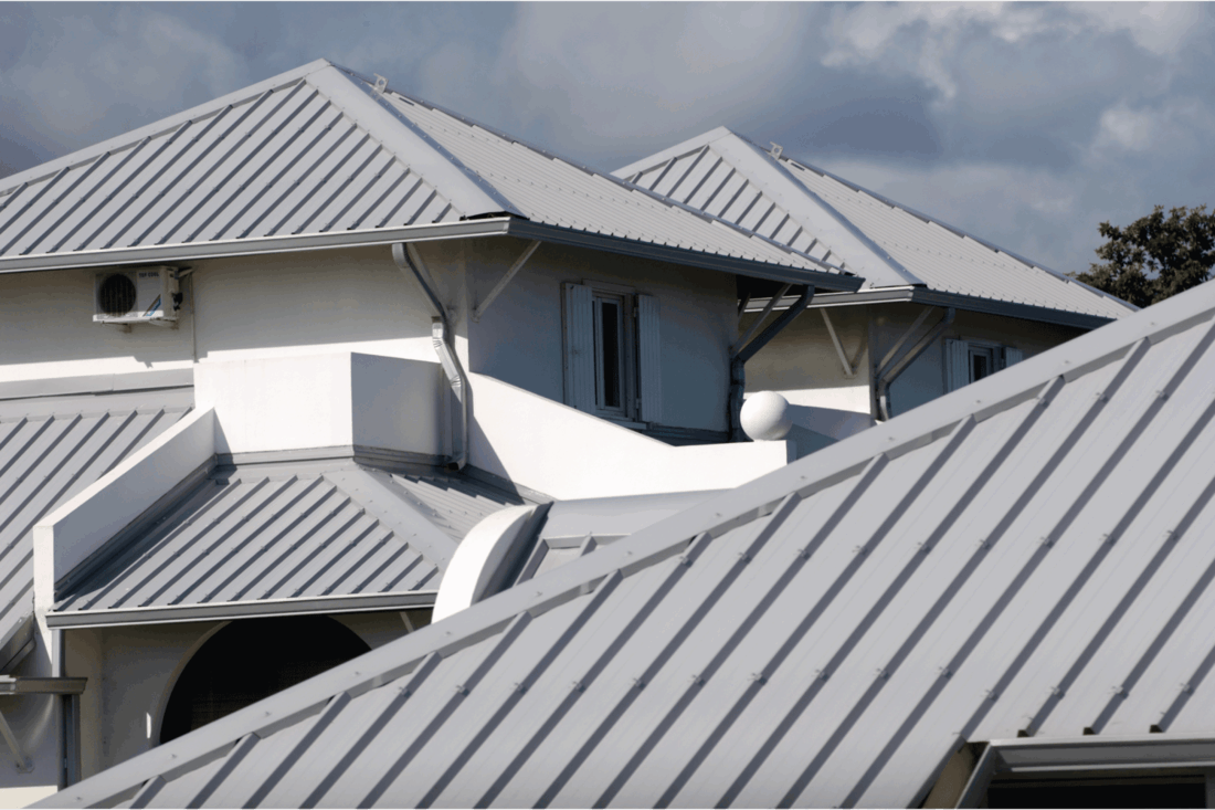 gray colored roofing on a white walled suburban house