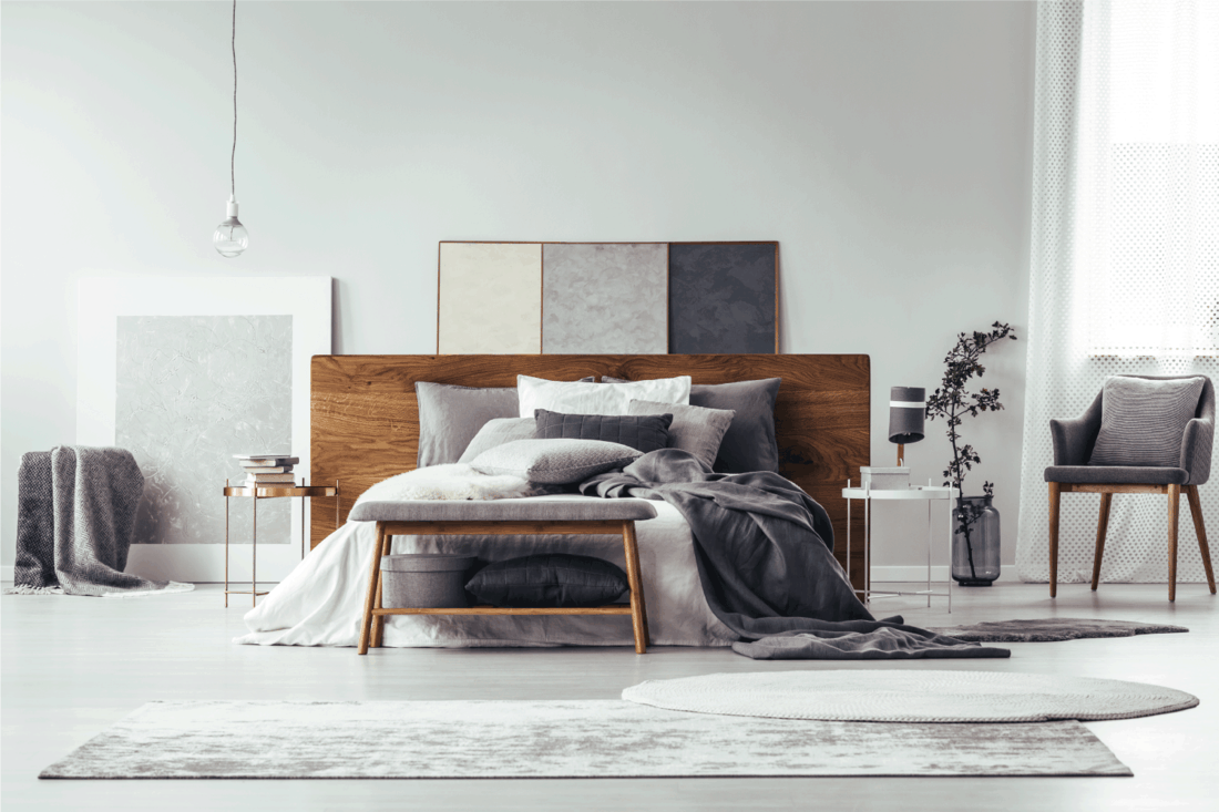 neutral Grey bedroom with simple painting, gray rug on the floor