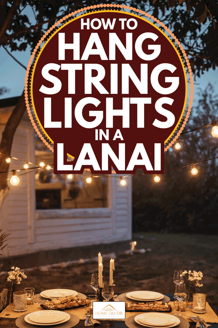 set table with a breathtaking view inside in a backyard with hanging string lights. How To Hang String Lights In A Lanai
