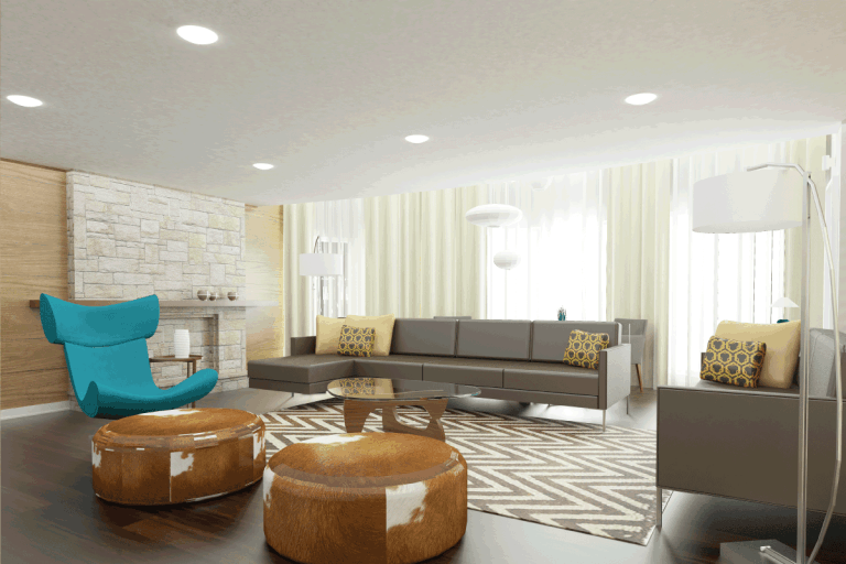 spacious living room with assorted furniture for seating and big bright recessed lighting. How Big And How Bright Should Recessed Lighting Be