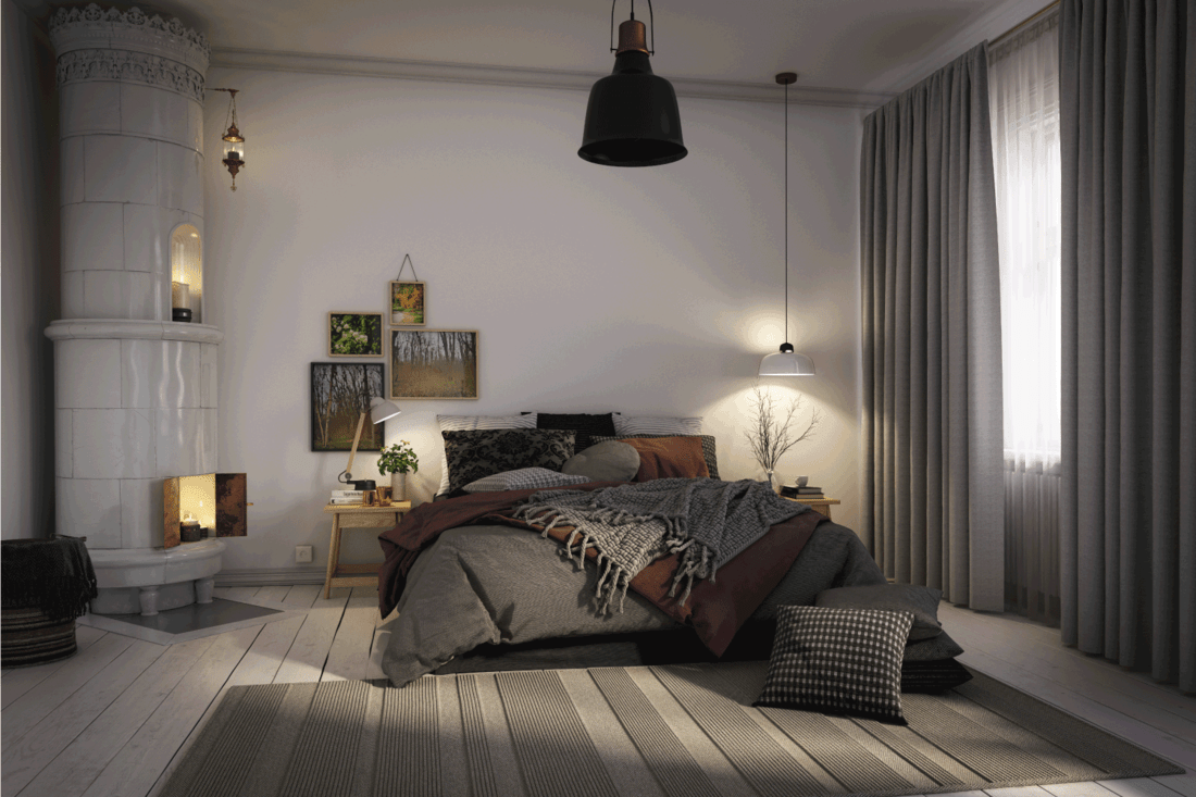 warm and cozy Scandinavian style bedroom interior with striped bedroom rug