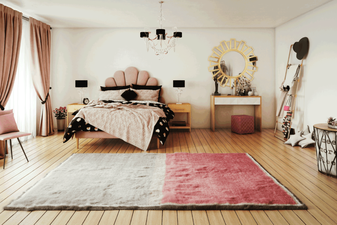 warm and cozy pink themed girl's bedroom interior design, with messy bed and lots of props.