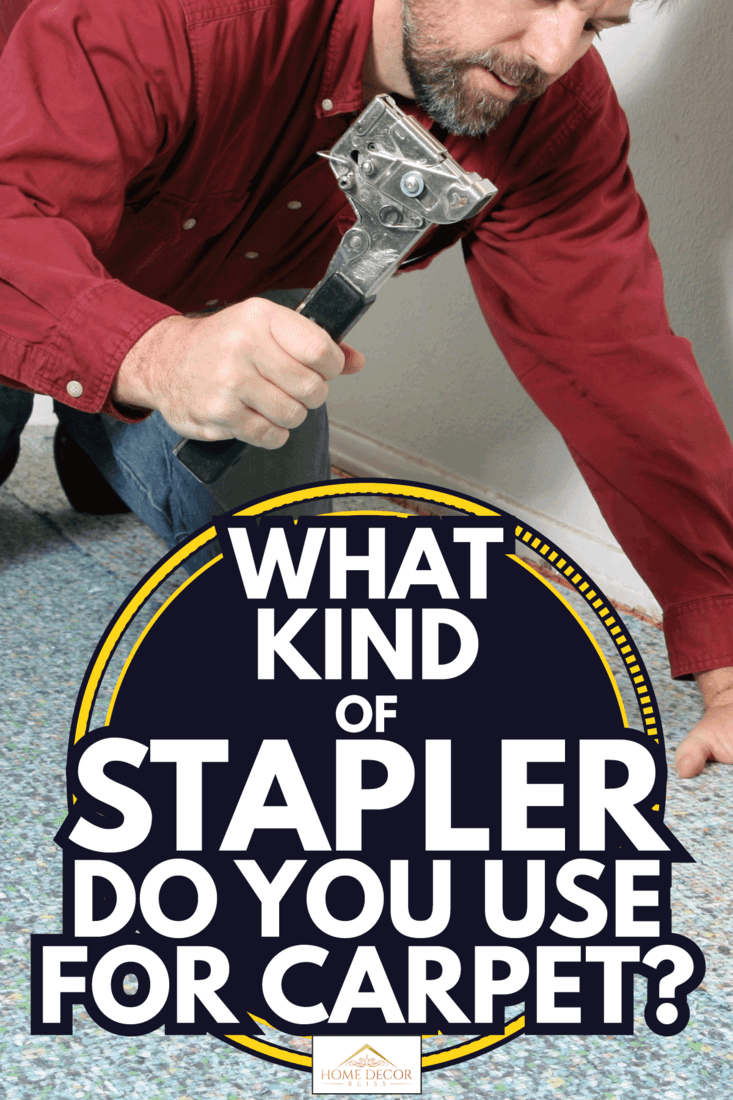 worker using hammer tacker for Padding going in before carpet in a living room. What Kind Of Stapler Do You Use For Carpet