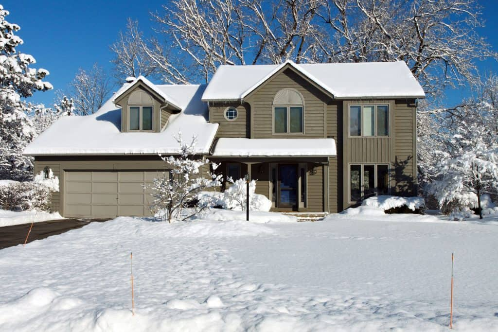 A big two storey country home covered in snow
