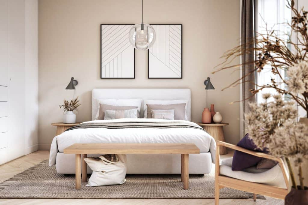 A boho themed bedroom with beige painted walls and other matching furnitures