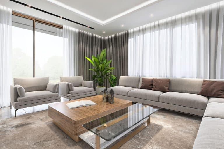 A luxurious apartment living room with long sectional sofas and a big wooden coffee table, What Color Should I Paint A Room With A Lot Of Natural Light?