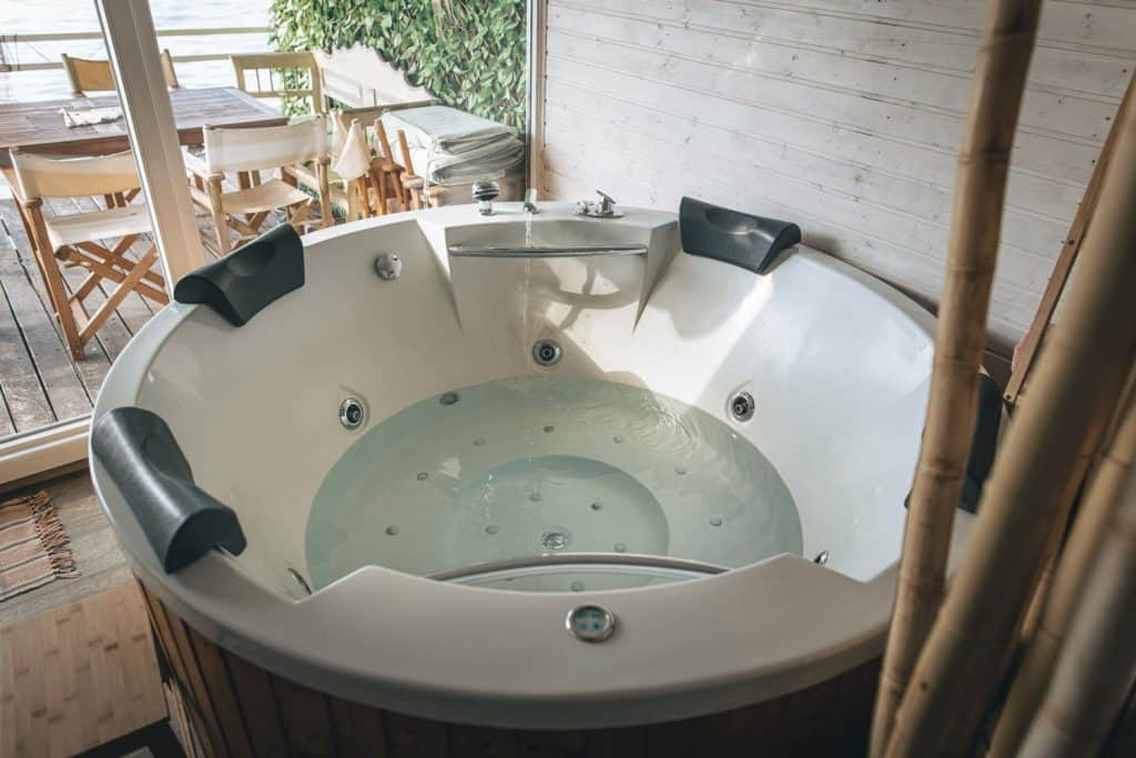 A small round hot tub inside a luxurious home