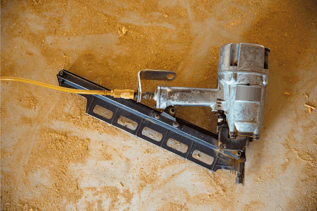 Air nail gun pneumatic framing nailer sawdust floor